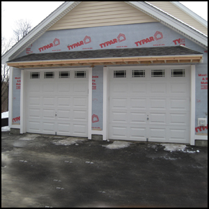 Garage door overhangs over back door hmm son could you for Garage overhang